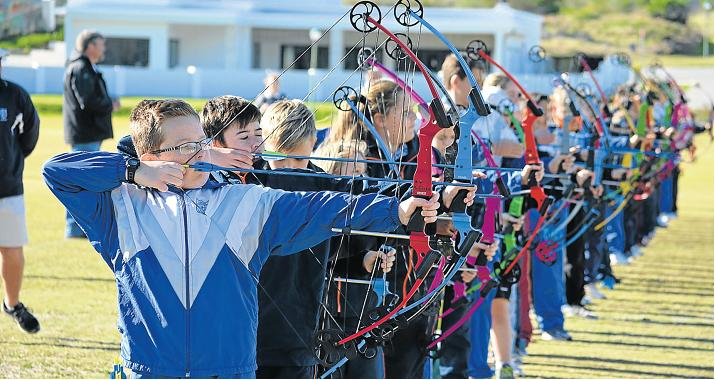 LET THE ARROWS FLY: Junior archers in action at the El Shaddai Bulls Eye Archery Competition held at the Port Alfred Country Club last Saturday. Picture: JON HOUZET