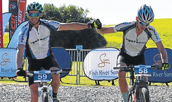 BACK FOR GOLD: Defending champions Richard Allen, left, and Bruce Campbell, cycling in the colours of Cyclo Pro from Port Elizabeth, crossed the finish line first last Sunday at the fourth Fish River Mountain Bike Challenge.