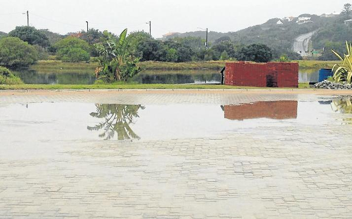 CAR(PARK) POOL: Recent rainfall saw water accumulating in the newly paved parking lot at the Port Alfred Duck Pond as a result of incorrect levels and inadequate drainage. Picture: JACOBUS GROVE