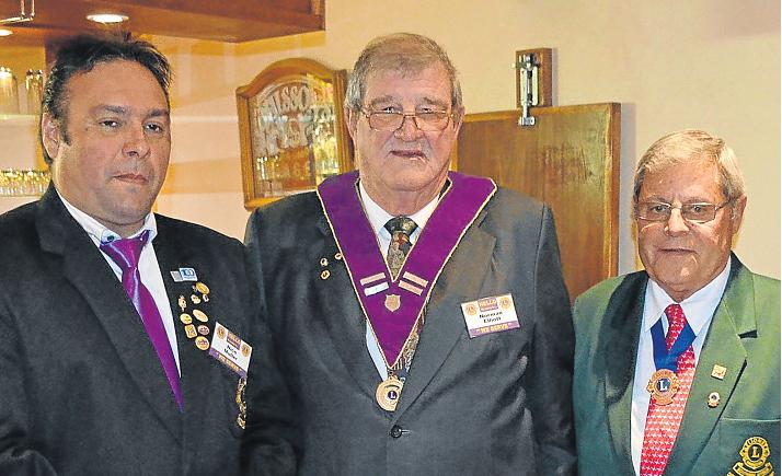 PICKING UP THE MANTLE: New Port Alfred Lions Club president Norman Elliott, centre, flanked by outgoing president Nico Muller, left, and immediate past district governor Bokkie Oberholtzer. Picture: JON HOUZET