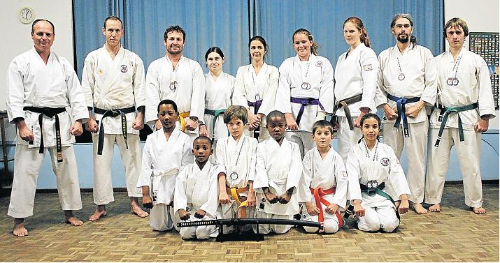 PROUD WINNERS: Some of the East Cape Shotokan-Ryu (ECSR) Port Alfred karateka, who formed part of the overall winning team at the recent SECKO Championships. ECSR placed ahead of 22 rival clubs to win this year's championship. In front is the katana sword trophy award for the overall winning club. Having also won the inaugural UWKSA National Championships in March, ECSR, members will be working hard towards a good showing at the Saska National Championships which will take place at the Fish River Sun Hotel from October 6 to 9. Picture: ROBIN SMITH