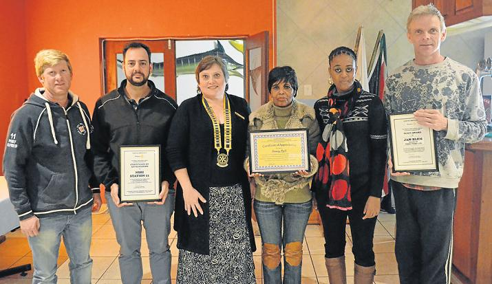 SELFLESS SERVICE: Receiving merit awards for their service to communities through their different organisations are, from left, NSRI deputy head Steven Slade, Juan Pretorius, Rotary president Ren Mouton, Rosemary Mogale, Margaret Mogale and Jan Blom. Picture: LOUISE CARTER