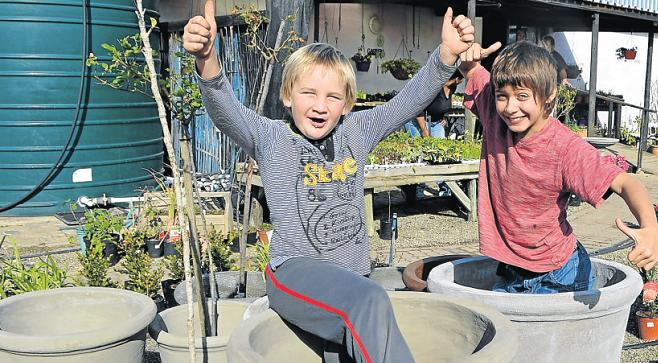 GOING POTTY: Showing off the range of garden pots now being manufactured at Red Leaf Nursery are Matthew, left, and Jonathan Steck. Picture: BRYAN SMITH
