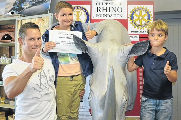 HEART OF GOLD: Animal lover Samuel Loubser, centre, put his birthday money where his heart is by donating it all to Chipembere Rhino Foundation last week, while he visited Root 72 with his dad, Dion, and little brother Beau. Picture: LOUISE CARTER
