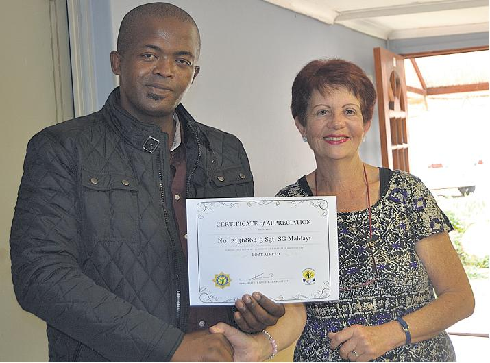 AWARD FOR GOOD WORK: For apprehending murder suspect Tonny Donile at the truck stop on the R72 at the top of Albany Road, sergeant Sindiso Govern Mablayi, left was presented with a certificate of appreciation by CPF chairwoman Heather Leicher at its meeting on Tuesday. Picture: ROB KNOWLES