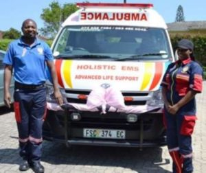 LIFE SAVERS: Holistic EMS Ambulance is your go-to ambulance service, ready to assist you and offering advanced life support, 24-hour emergency care, ICU transfers, as well as training. Call on Karen Romans and her team who offer their hands to help save lives. Holistic EMS is commemorating breast cancer awareness month with a pink ribbon decorating their ambulance. Basic ambulance assistants Malackias Chirombe, left, and Pheleka Mdyu are pictured with the vehicle Picture: JON HOUZET