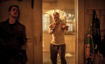SHUT IN: A blind man (Stephen Lang) whose daughter was killed by a motorist stalks a home invader Alex (Dylan Minnette) who is holding his breath to escape the blind man's attention in 'Don't Breathe', now showing at Rosehill Cinema