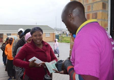 GOOD VIBRATIONS: Despite the rainy and cold conditions voters for Ward 7 lined up at the Kuyasa Combined School polling station and were in good spirits