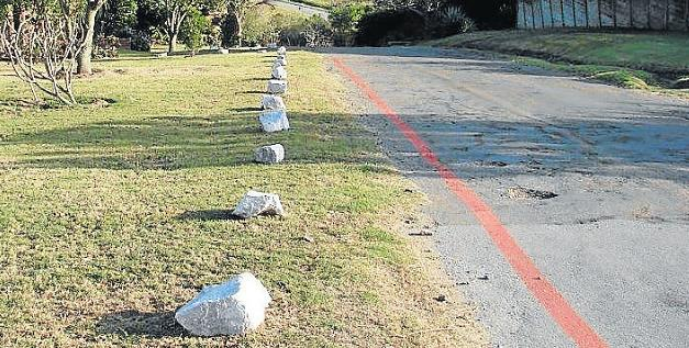 NOT RIGHT: A reader took this photo showing how a resident blocked off the road verges in Atherstone and Marlin roads with rocks Picture: SYLVIA MURDOCH