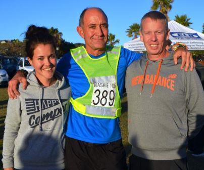 IN MEMORY OF A FRIEND: Anthony Bold, centre, of Pretoria was running his first Washie, supported by his daughter Claudia and her fiancé John Knox Picture: JON HOUZET