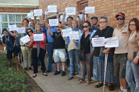 OUTRAGE: Friends of murdered businessman Noel Maddocks hold up signs calling for justice before the court appearance of his alleged killer, tavern owner Tonny Donile Picture: JON HOUZET