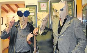 BAG-PEOPLE: Paper bag masks, made specifically for the Bathurst Art Fair on Saturday and Sunday, were the order of Friday evening at the Engage Art Centre opening. From left are Peter Mosley, Tharine de Vos and Bert Brummer Picture: ROB KNOWLES