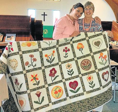 FETED TO WIN: Port Alfred Methodist Church recently held a fete and wishes to thank the community for their support. First prize in their raffle, won by Bronwyn Dorrington, left, was a beautiful hand-made quilt made by Di Long.