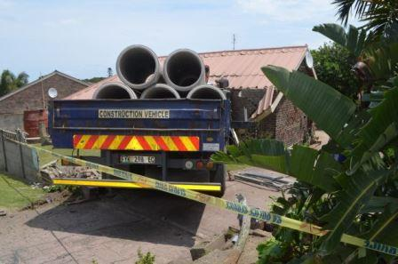 NASTY SHOCK: This SJW plant truck carrying huge concrete pipes for construction on Albany Road crashed through the living room of a house in Galpin Close last Friday. No one was hurt Picture: JON HOUZET