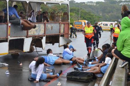 HELP IS ON THE WAY: Pupils ham it up as the 'victims' of a bus accident on Port Alfred's Nico Malan Bridge, a simulation to test coordinated rescue response efforts in times of disaster Picture: JON HOUZET