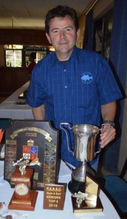 REELING IN THE TROPHIES: Niall Borland was one of the anglers who received multiple awards at the Port Alfred Ski-boat Club's Rock and Surf section annual prize giving last Friday night Picture: JON HOUZET
