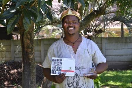 TAKING HOME THE GREEN: Minet Rastar Nojoko with the 2017 local heroes calendar and trophy that he won at the Daily Dispatch Local Heroes competition on Thursday November 25