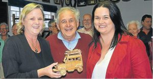 FINE WORK: Derek Brockwell from Kenton, centre, received a prize of a toolbox and tools from Buco at the Woodworker's Guild AGM recently for his toy car, just one of many toys created by guild members and donated to Child Welfare Port Alfred and Kenton. Selecting his toy as the winner was Susan Harty, left, and Rose Downer from Child Welfare. Picture: ROB KNOWLES