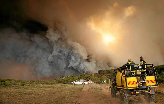 Thousands evacuated in South Africa as storm fans fires